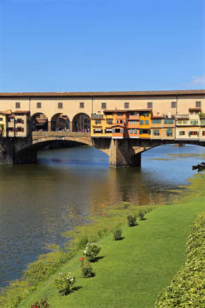 saturated: Florence Italy Old Bridge called Ponte Vecchio over River Arno