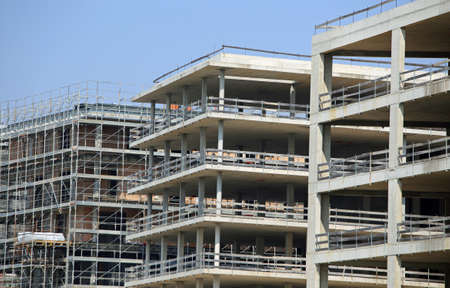 overbuilding: immense building under construction with concrete walls in the city Stock Photo