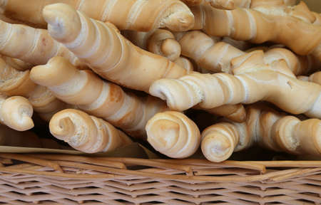 basket with fragrant bread shaped like a small horn typical of central Italy Stock Photo