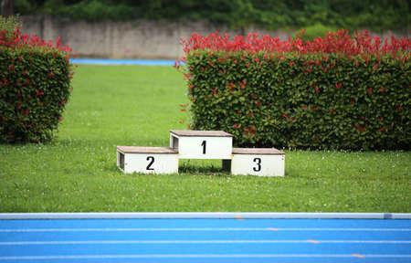 podium of an athletics stadium with numbers