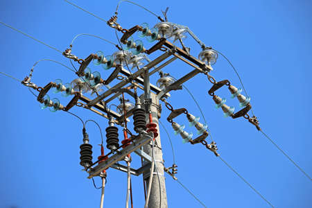 switches: switches in air of a high voltage power line with  concrete pole and electrical insulators Stock Photo