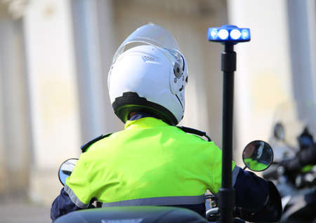 police officer on motorcycle with flashing blue siren Stock Photo
