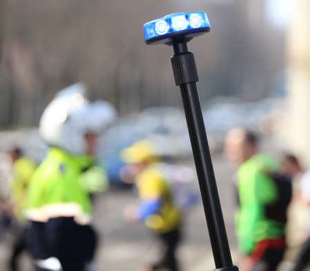 police flashing siren and a traffic officer on the street
