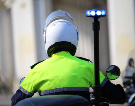 police officer on motorcycle with flashing blue siren in the city Stock Photo