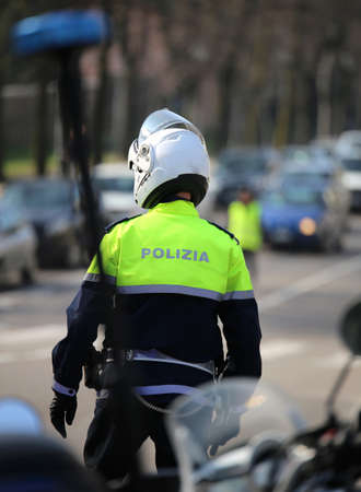 siren of italian police motorcycle and a traffic officer on the street