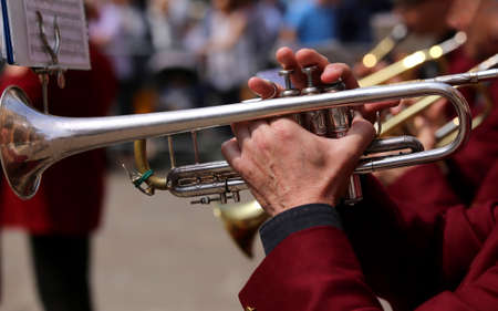 trumpet player: trumpet player plays during an outdoor live performance of a brass band