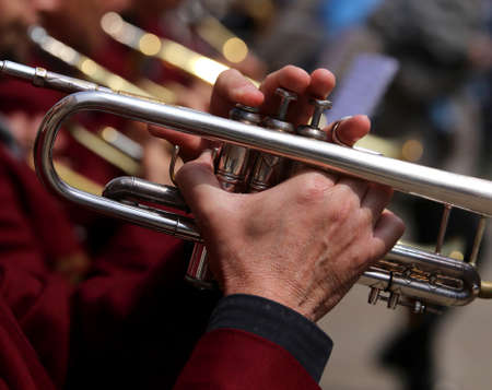 trumpet player: trumpet player plays during an outdoor exhibition of a brass band