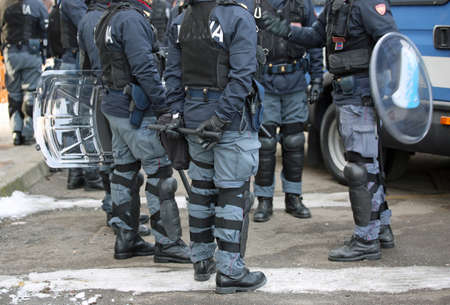 policing: Vicenza, VI, Italy - January 28, 2017: Italian police riot squad with body armor while patrolling the city before the arrival of fans of a football game Editorial