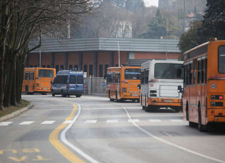 Vicenza, VI, Italy - January 28, 2017: armed escort of the Italian police during the transfer of football fans in the bus into town before the soccer match with the Italian football teams Vicenza vs Ferrara