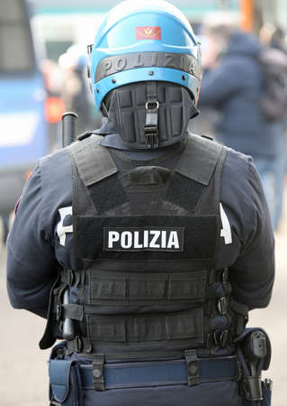 policing: Vicenza, VI, Italy - January 28, 2017: Italian police riot squad with blue helmet while patrolling the city before the arrival of fans of a football game