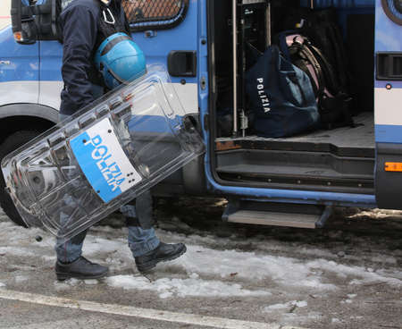 Vicenza, VI, Italy - January 28, 2017: Italian police riot squad with blue helmet while patrolling the city before the arrival of fans of a football game