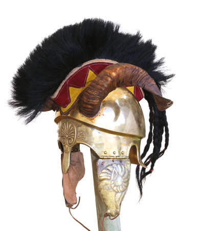 Ancient helmet of a soldier with horn and metal decorations