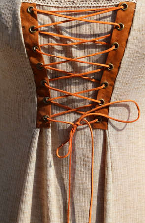 duffle: intertwining with the string of an ancient medieval dress in cotton and leather