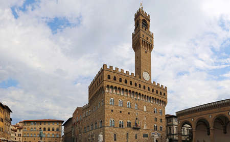 wide-angle photograph of the old palace in Florence with Tower in the main square called Piazza della Signoria