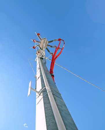 or electrocution: big pole of an electrical system with cables and high voltage insulators of a voltage transformer