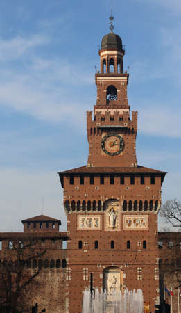 sforza: Milan Italy Ancient Big Tower of old Castle called Castello Sforzesco with fountain in winter Editorial