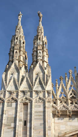 Milan, Italy Detail of Facade of Gothic Cathedral called Duomo di Milan in Italy wtih blue sky Stock Photo