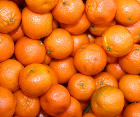 untreated: Organic orange mandarins and clementines with peel untreated with chemicals for sale in the healthy and natural food store in winter