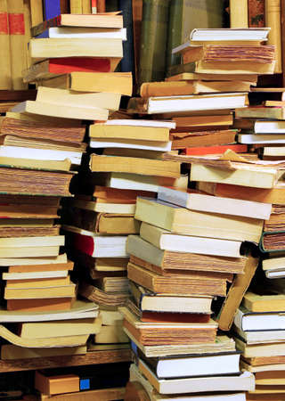 knew: many piles of old books for sale in an old library Stock Photo