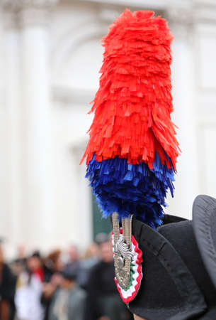 panache: red and blue plume over the dress uniform hat of an Italian military police armed corpscalled Carabinieri