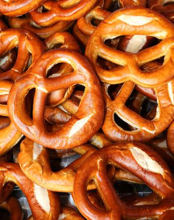 Background of baked pretzels for sale in market
