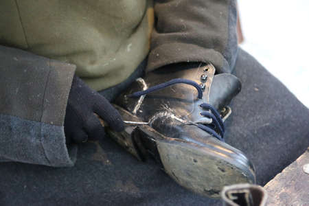 senior expert shoemaker while repairing an old leather shoe