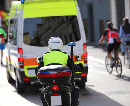 escorting: motorcycle police while escorting an ambulance in the traffic in the city