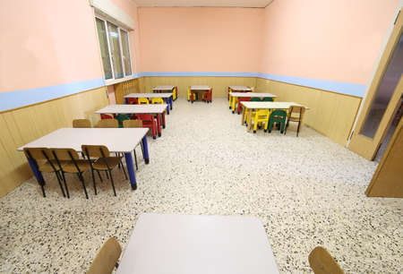 diningroom: refectory of a school for children with small chairs and tables to eat lunch without people photographed by fisheye lens