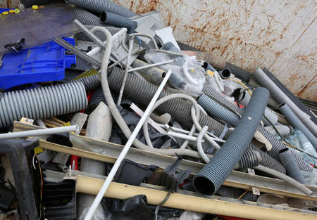 repurpose: plastic pipes and recyclable material broken in a refuse collection centre Stock Photo