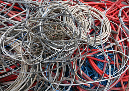electric cables of many colours for the recycling of copper in a reusable waste collection Center