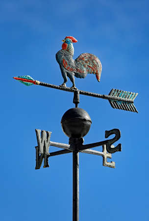 cardinal points: weather vane to indicate the wind direction with a rooster in wrought iron and arrows of Cardinal Points North East South West