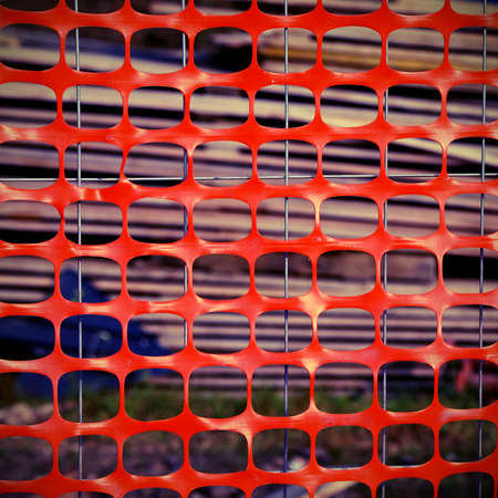delimit: Plastic net of protection of a construction site during the construction of a building Stock Photo