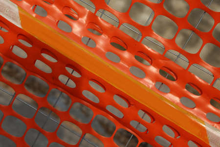delimit: Plastic orange safety net to delimit the area of a construction site in the city Stock Photo