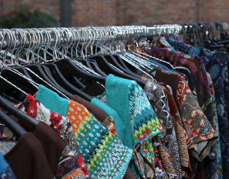 stall with many vintage clothes hanging