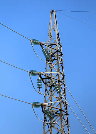 great pylon of high voltage cables with tempered glass insulators Stock Photo