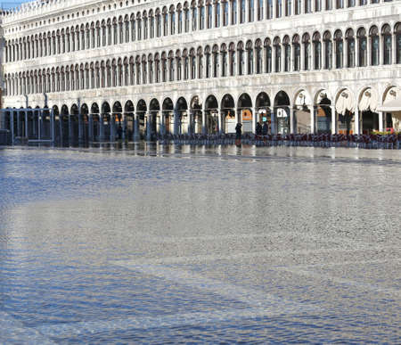 procuratie: Venezia, VE, Italy - January 31, 2015: high tide and the palace called Procuratie Vecchie in Saint Mark Square