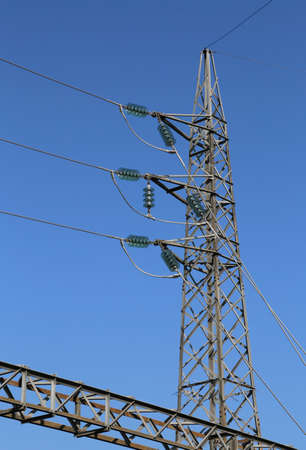 big pylon of high voltage cables with tempered glass insulators