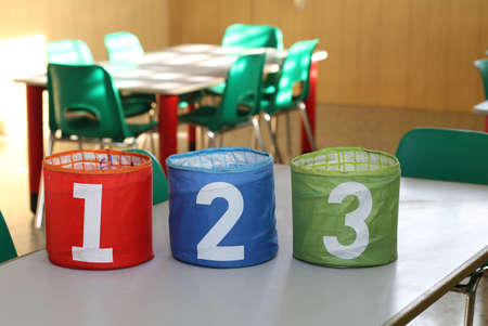 double game: three big jars with big numbers one two three in a classroom of a school Stock Photo