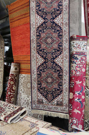 many carpets for sale in the ethnic market stall