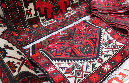 heap of many of various origin and quality carpets