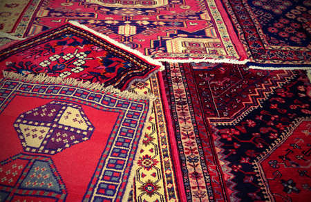 prayer rug: many carpets available to be used by people to kneel