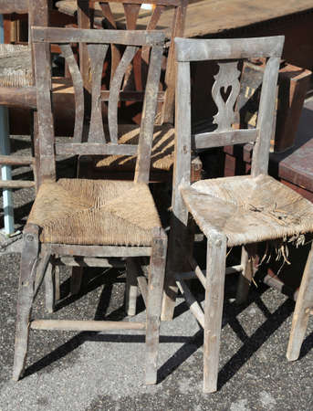 Old Wicker Chairs For Sale In The Outdoor Antiques Market Photo
