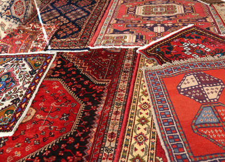 carpets of different nationalities and quality on sale in the market