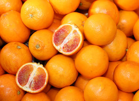 Oranges and slices of an orange cut in the greengrocers stall
