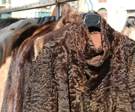 fur coats and clothes for sale in the hanger in the market