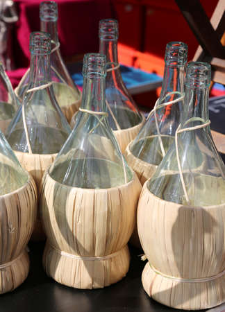 flasks for holding wine with straw coating
