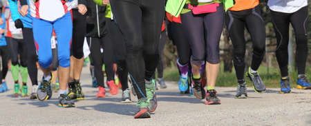 retardation: large group of male and female runners during sports ride into town Stock Photo