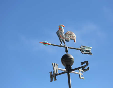 cardinal points: weathervaneto mark the wind with the arrow of the cardinal points and a rooster on