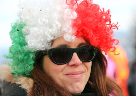 peruke: beautiful girl with a big wig red white green and sunglasses