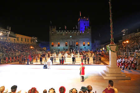 reenactment re enactment: Marostica, VI, Italy - September 9, 2016: historical reenactment and human chess game with real people and the ancient castle in background Editorial